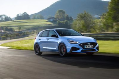 The new i30 N driving on a race track.